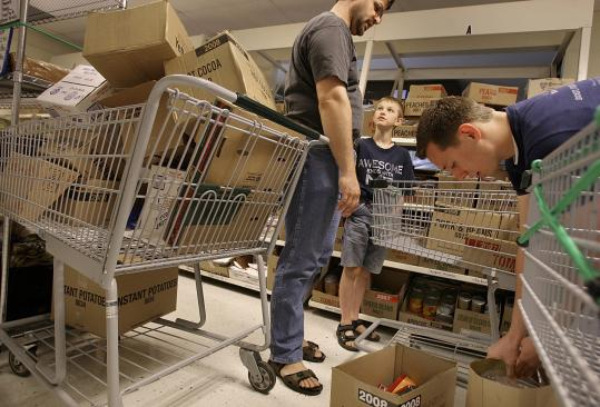 Andres Saenz of Peabody visited the Mormon storehouse. His father, Robert, is supporting six people, including his in-laws, and has been struggling to make ends meet at his real estate job.
