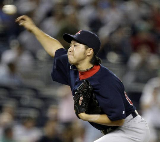 Junichi Tazawa, appearing in the 14th inning of a scoreless game, lets fly with the first pitch of his major league career.