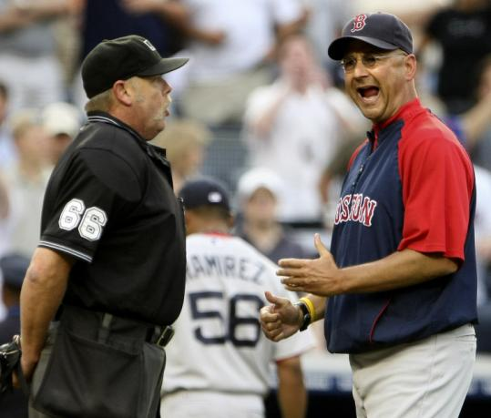 Ramon Ramirez's ejection in the seventh prompted Terry Francona to have an animated talk with umpire Jim Joyce.