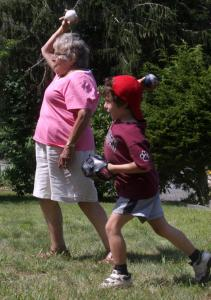 Sara Bejoian and grandson Benjamin practiced at her home in Chatham for their appearance at the Oldtime Baseball Game in Cambridge.