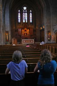 Worshippers prayed before a consecrated wafer at St. Clement Eucharistic Shrine.