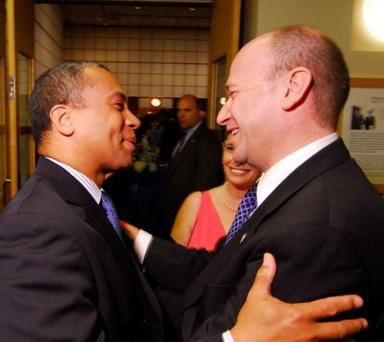 Governor Deval Patrick greeted Nadav Tamir, Israel's consul general for New England, at a function at the JFK Museum in May of 2008.