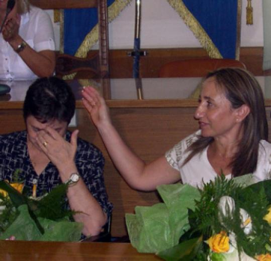In Ortona, Italy, Alessandra Costanzo (left) responded to news her husband, Commander Mario Iarlori, and his crew had been freed.