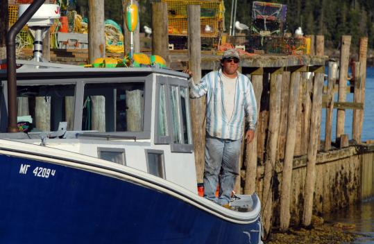 Keith Simmonds suspects other lobstermen of sinking his lobster boat last week off Owls Head in Maine.