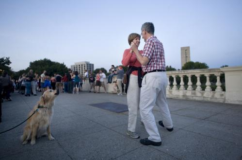 Tom and Lucy Stair practiced their tango steps while Nellie, the couple's golden retriever, watched. 'We've had a few lessons,' Tom said. 'And Nellie has learned how to sit, but not to tango.'