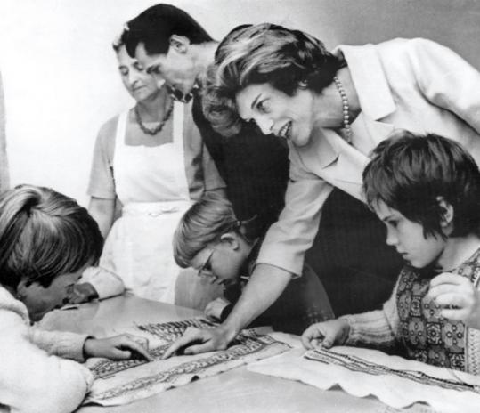 Eunice Kennedy Shriver visited a home in Bonn for retarded children on a trip with President Kennedy.