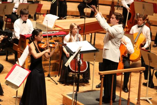 Ryan McAdams, conducting fellow at Tanglewood Music Center, and violinist Stephanie Nussbaum at work in John Zorn's 'Contes de fées.''