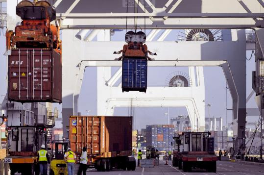 Containers were unloaded off a cargo ship at the Georgia Port Authority's Garden City terminal in Garden City, Ga., yesterday. The US trade deficit rose in June as both imports and exports increased.