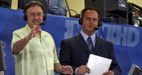 Jerry Remy (left) acknowledges the cheers of the Fenway crowd during his visit to the booth.