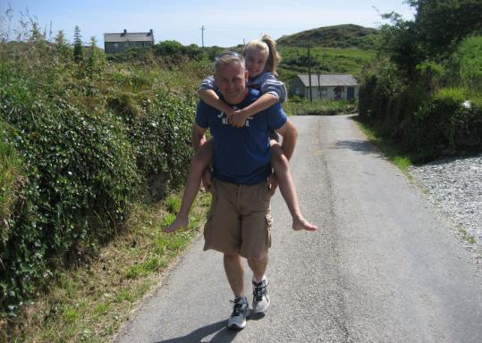 Jim McLoughney and his daughter, Sarah, on a recent visit to Ireland. In 2000, the family moved there.