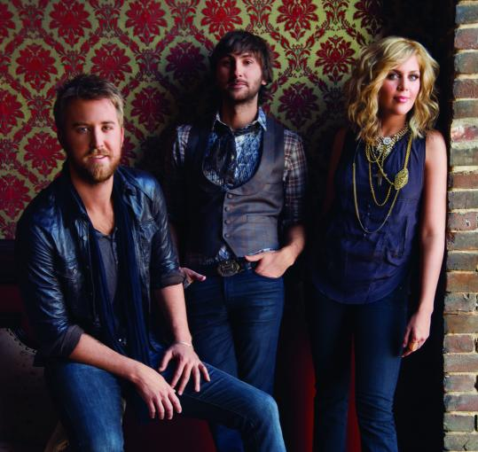 Hillary Scott with Lady Antebellum bandmates Charles Kelley (left) and Dave Haywood.
