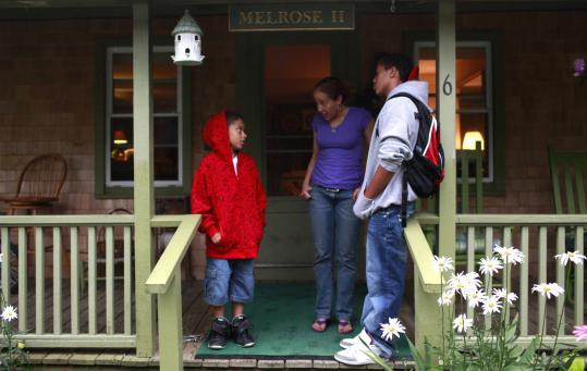 MAISIE CROW FOR THE BOSTON GLOBEGretchen Mercer with her sons Brandon (left) and Jason on the porch of her family's home in Oak Bluffs. The home has been in her family for generations.