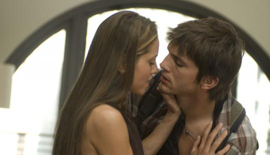 "Margarita Levieva and Ashton Kutcher in ""Spread.''"