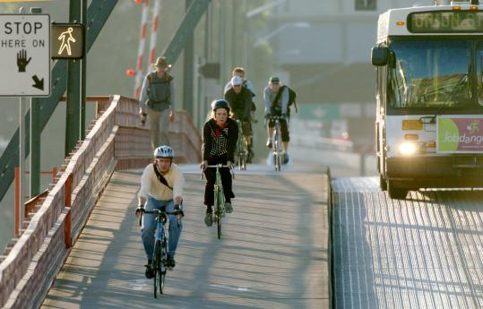 Bicycling commuters headed downtown over the Hawthorne Bridge in Portland, Ore. Since the 1970s, the city has built about 300 miles of bicycle lanes, and, as a result, has biking rates that are about eight times the national average.