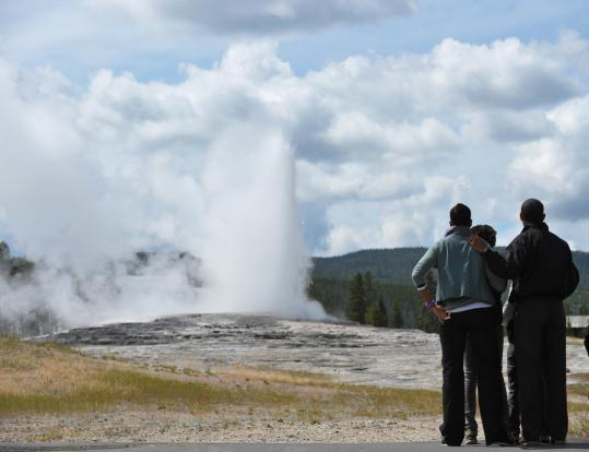 On a family trip, President Obama, first lady Michelle Obama, and their daughters watched the eruption of the Old Faithful Geyser at Yellowstone National Park yesterday.