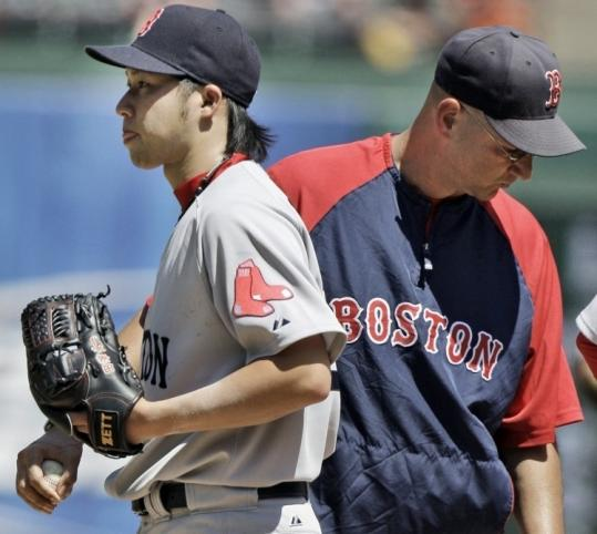 "Terry Francona lifts Junichi Tazawa yesterday; he said the youngster ""didn't have the best life on his fastball.''"