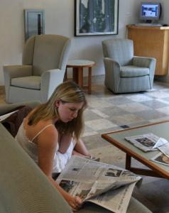 Holy Cross freshman Mia Huntley of Andover scanned a newspaper as part of her summer assignment. She looks for arts coverage daily.