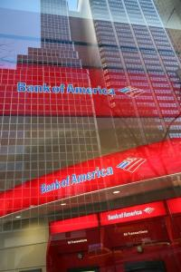 Bank of America wrote off fewer accounts in July, and its net loss rate fell to 13.81 percent from 13.86.