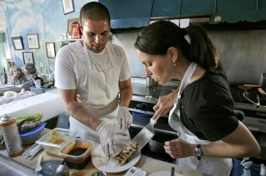 The author gets a hand from chef-owner Brad DeLibero at Mad Martha's Beach Cafe in Newbury.