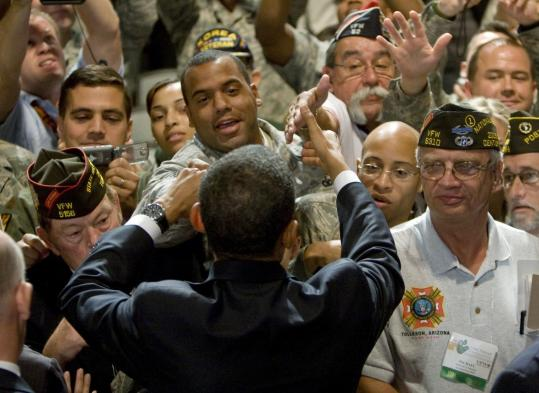 President Obama greeted VFW conventioneers yesterday in Phoenix. He vowed that no veterans' medical benefits would be cut.