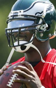Eagles coach Andy Reid is interested in Michael Vick the football player.
