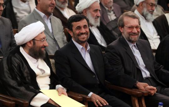 Sadeq Larijani (left) sat with Mahmoud Ahmadinejad and Ali Larijani at yesterday's swearing-in ceremony in Tehran.