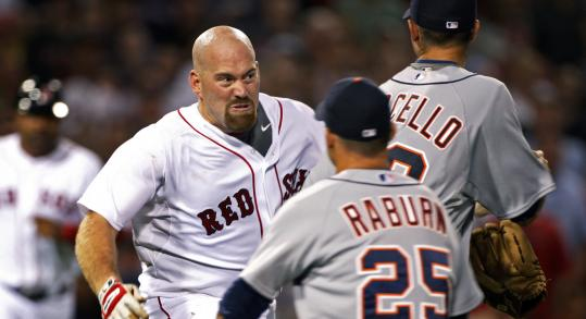 The Sox's Kevin Youkilis charged after Tigers pitcher Rick Porcello after being hit by a pitch.