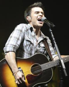 Kris Allen (left) appeared as the last act of the night, crooning such favorites as 'Ain't No Sunshine When She's Gone.'