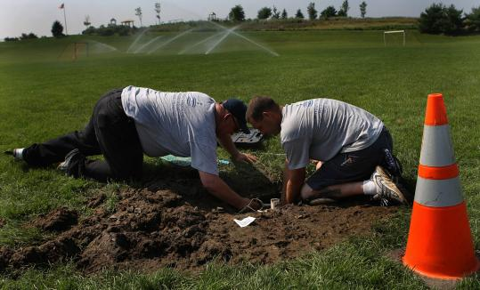 Dave Figueiredo (left at a Irrigator Services worksite with Josh Dube) says his lawn watering business is down by 50 percent.