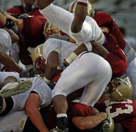BC's Jeff Smith, who scored the offense's only TD, couldn't find much room on this play during last night's scrimmage.