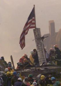 An American flag was raised at ground zero as crews sifted through the rubble at the World Trade Center after 9/11.