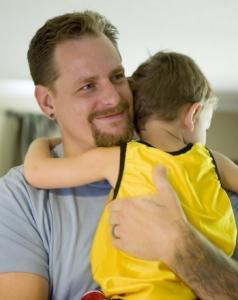 Navy veteran Donny Spradling, shown with son Isaac, will be taking largely introductory courses this fall.