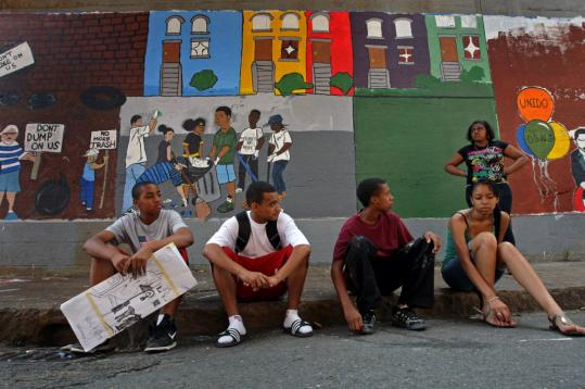 A group of the artists — Malik Canty, Arnaldo Dossantos, Daishawn Riddick, Adriana Lobo, and Clarissa Beckham — sat with part of the mural in the background. A peace offering from the state may be too late.