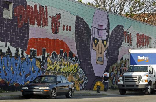 A mural covered the side of a building at 510 Lincoln St. in Allston. But amid controversy, the wall is to be painted over.