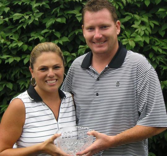 Sara Libin and Eric McPhail celebrate their matching victories at Watertown's Oakley Country Club.