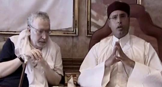 This Libyan Al-Motawassit channel TV grab showed Megrahi (left) with Moammar Khadafy's son Seif al-Islam yesterday.