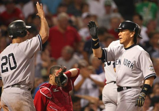 John Tlumacki/Globe StaffRed Sox catcher Victor Martinez hides his eyes as Hideki Matsui (right) is congratulated by Jorge Posada after the Yankee DH homered in the fifth.