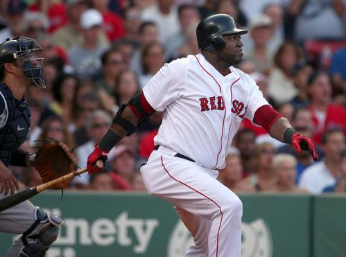 Designated hitter David Ortiz hits a solo home run off A.J. Burnett in the fifth.