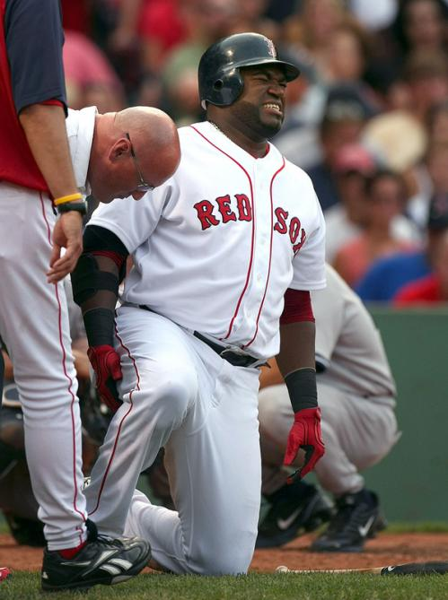 David Ortiz grimaces after taking tweaking his ankle while fouling off a pitch in the sixth inning. Ortiz stayed in the game.