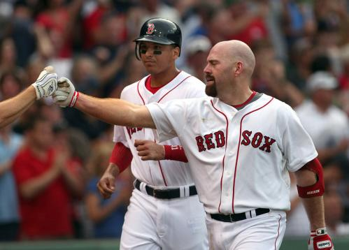 Kevin Youkillis is congratulated as he nears the dugout with Victor Martinez in tow after Youkilis's two-run, sixth-inning homer.