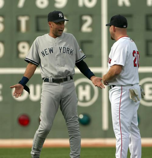 Before the game, Yankees shortstop Derek Jeter (left) talks with Kevin Youkillis.