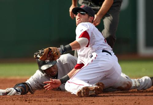Robinson Cano is tagged out at second base by Dustin Pedroia, but Pedroia paid for the out (with an assist to left fielder Jason Bay) by taking Cano's helmet to his face. Pedroia stayed in the game.