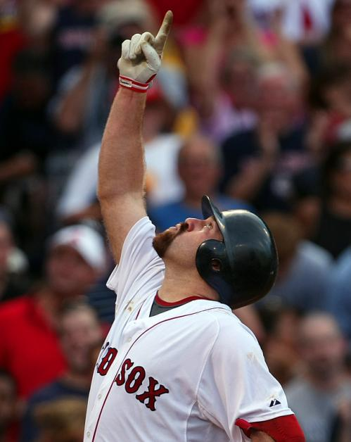 Red Sox third baseman Kevin Youkillis points skyward as he crosses the plate after hitting one of two home runs on the day as Boston trounced the Yankees, 14-1, at Fenway Park. Stroll through our gallery to see more scenes from Saturday's game.