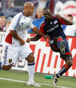 Kheli Dube, who did it all for the Revolution offensively, battles Real Salt Lake's Robbie Russell.