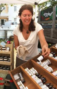 Health care was a hot topic at the farmers' market in West Tisbury, where Holly Bellebuono sells herbs