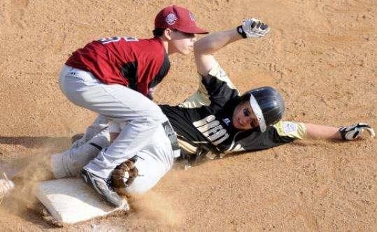 Third baseman Nick Bona tags out Kentucky's Ian Woodall in the fifth inning of Peabody's 12-3 victory in pool play.