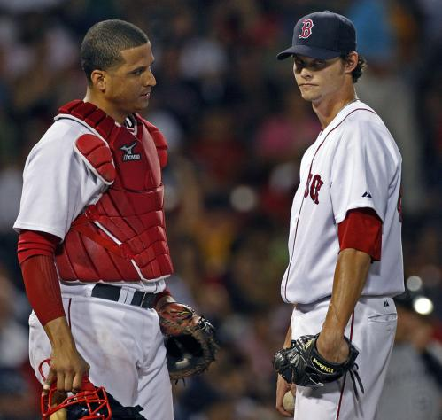 Clay Buchholz (right) conferences with catcher Victor Martinez after giving up a home run that forced him from the game after 4 2/3 innings. Buchholz gave up seven earned runs on six hits, while striking out three and walking three.