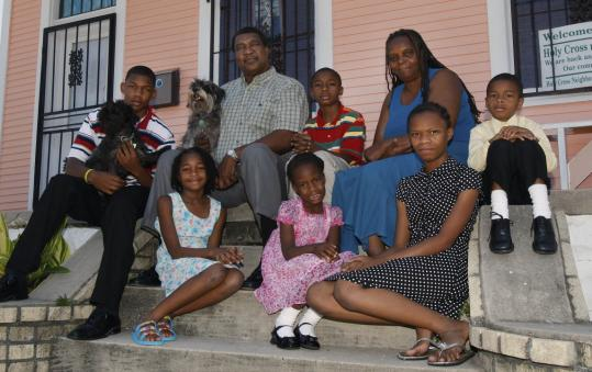 Collins and Shelia Phillips with their grandchildren on the steps of their 9th Ward home in New Orleans. Their house is still being renovated after Hurricane Katrina struck in August 2005.