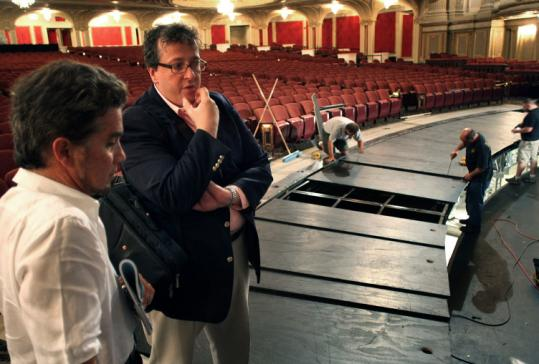 Boston Ballet's Jonathan McPhee (left) and Barry Hughson inspect work on the Opera House's orchestra pit.
