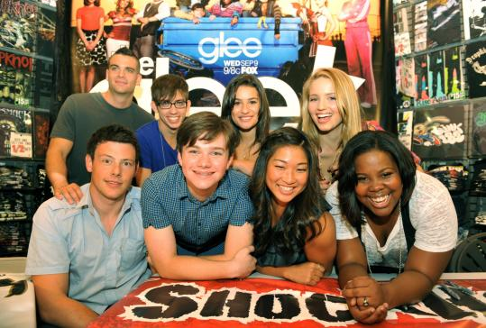 "A gathering of the ""Glee'' cast (clockwise from top left: Mark Salling, Kevin McHale, Lea Michele, Dianna Agron, Amber Riley, Jenna Ushkowitz, Chris Colfer, and Cory Monteith) at the Natick Mall brought smiles, songs, and cheers from their fans and looks of surprise from the actors."